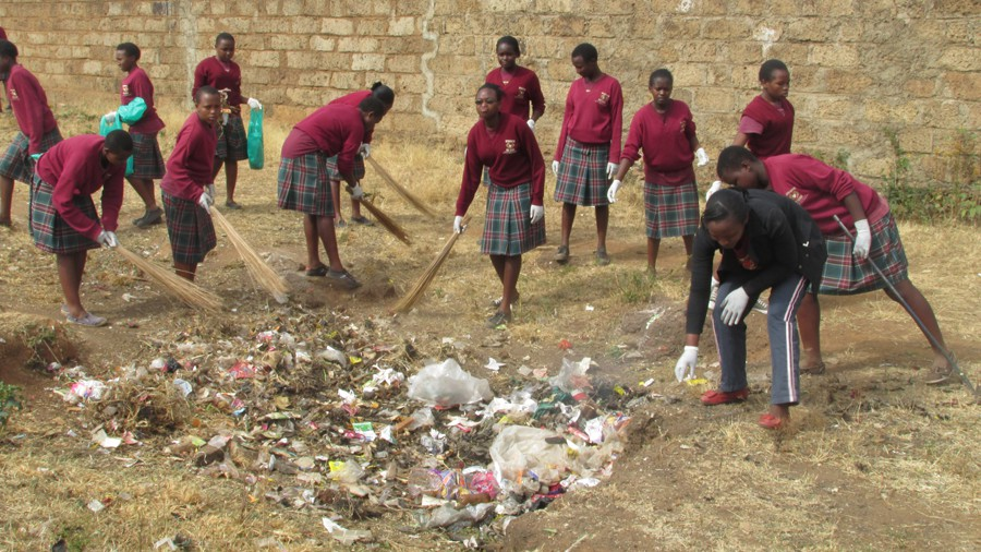 Caring Hearts High School students on a community service project cleaning Nguluni the nearest town to the school